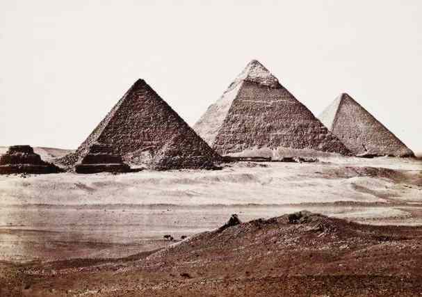 The Giza Pyramids rise like mountains from the desert.