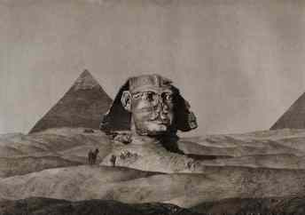Buried in sand up to its neck, the Sphinx endures.